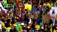 South African team parade through Johannesburg SOUTH AFRICA Johannesburg EXT Opentop bus carrying South African national football team along Man...