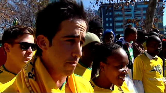 South African team parade through Johannesburg SOUTH AFRICA Johannesburg SHOT past cheering people lining street PAN across crowd of people some...