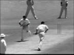 4th test 1st day SOUTH AFRICA Johannesburg Peter May leads team out / MS 2 people onlooking in sun / GV Statham to Goddard who scores runs zoom in /...