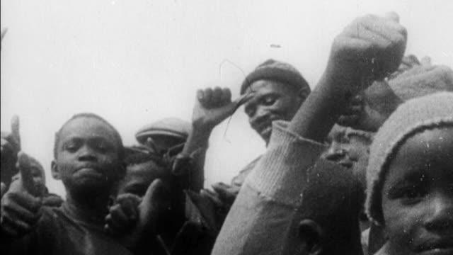 South African civilians burning passbooks in protest of Apartheid / attempted assassination of Premier Hendrik Verwoerd by white farmer David Pratt...