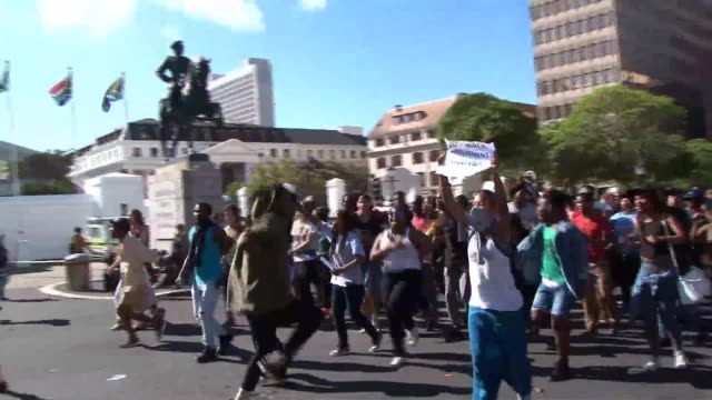 South African riot police used stun grenades to disperse protesting students outside parliament in Cape Town on Wednesday as demonstrations against...