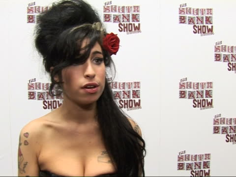 Photocall and interviews Amy Winehouse interview SOT On prestige of South Bank Show Award / No I'm quite an ignorant person / But I guess I know what...