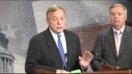 South Carolina Senator Lindsey Graham and Illinois Senator Dick Durbin answer questions from reporters at a briefing on their reintroduction of the...