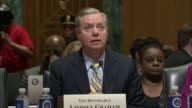 South Carolina Senator Lindsey Graham reads prepared remarks at a hearing of the Senate Finance Committee on a health care block grant bill...