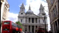 South Churchyard at St Paul's Cathedral reopened after refurbishment ENGLAND London EXT Front of St Paul's Cathedral with buses and pedestrians in...