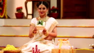 South indian woman celebrating diwali festival, Delhi, India