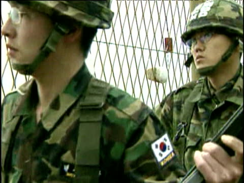 South Korean armed soldiers check security fence on border with North Korea 2004
