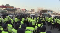 South Korean riot police and farmers stand face to face during an AntiGovernment rally at Ansung toll gate in Ansung South Korea The planned farmers'...