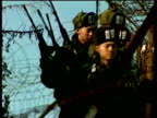 South Korean soldiers with rifles patrolling demilitarized zone Jun 00