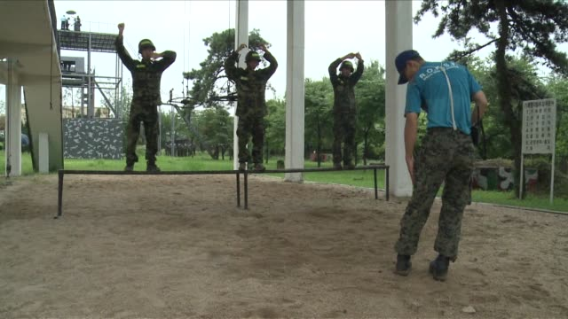 South Koreans are turning out in droves for an odd summer vacation military boot camp Seoul South Korea