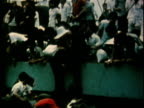 South Vietnamese refugees climbing aboard crowded passenger ship after the fall of Saigon / Saigon South Vietnam