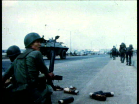 South Vietnamese troops pinned down on Newport Bridge / Troops fire mortar / Soldier carrying injured comrade on back / Troops bringing back wounded...