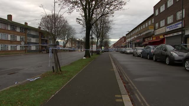 police cordon general views ENGLAND London Southall Lady Margaret Road EXT Various of road sealed off by the police following fatal shooting and...