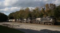 'A Southbound Norfolk Southern freight train passes through Burnside Kentucky US on Friday October 17 Wide shot of train not moving on train tracks...