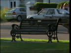 SouthendonSea park / general views of park grounds Park bench as passersby along past / park flowerbed with pink flowers and shubs / more of park...