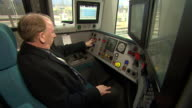A Southern Rail Train driver closes the doors from his drivers cabin