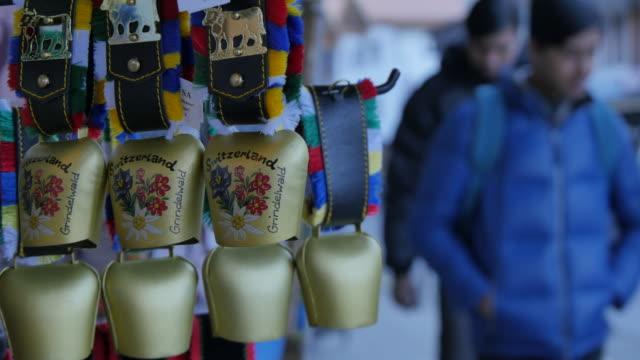 Souvenir Swiss cow bells on the main street, Grindelwald, Jungfrau region, Bernese Oberland, Swiss Alps, Switzerland, Europe