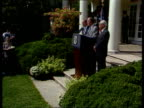Crisis meeting USA Washington Pres George Bush along to podium MS Joined by Sec of State James Baker White House Robert Strauss MS All standing at...