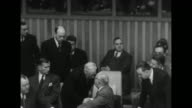 Soviet Foreign Minister Andrey Vyshinsky walks up to table from behind where UN Secretary General Trygve Lie of Norway sits and shakes hands with UN...