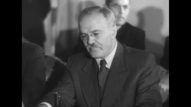 Soviet Foreign Minister Vyacheslav Molotov enters meeting room greeted by Czech Deputy Prime Minister Zdenek Fierlinger then shakes hands with other...