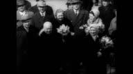 / Soviet propaganda film commemorating Yuri Gagarin's first manned space flight airport crowds cheering holding signs of Gagarin Nikita Khrushchev...