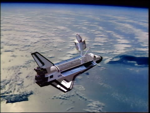 COMPUTER ANIMATED space shuttle Endeavour assembling International Space Station components in space