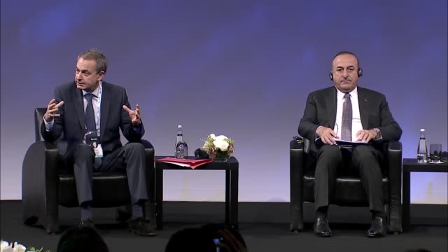 Spain's former Prime Minister Jose Luis Rodriguez Zapatero and Turkish Foreign Minister Mevlut Cavusoglu attend an open session of the international...