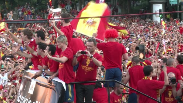 Spain's triumphant Euro 2012 heroes parted a redandyellow sea of fans in central Madrid on Monday in a giant deafening national fiesta that swept...