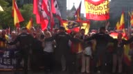 Spanish demonstrators protest outside the Madrid City Hall as President of the Catalan government Carles Puigdemont arrived to give his address at a...
