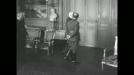 MS Spanish dictator Francisco Franco and Vichy French Leader HenriPhilippe Petain enter room followed by retinue / MS semi rear view of Franco and...