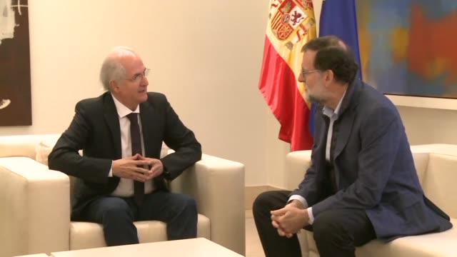 Spanish Prime Minister Mariano Rajoy meets former Caracas mayor Antonio Ledezma in Madrid