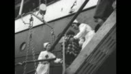 GV Spanish ship 'Habana' flying the flag of England docked in harbor / Basque children evacuated during the Spanish Civil War cheer and wave from...