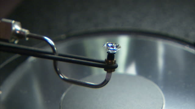 A sparkling diamond rotates on the tip of a machine.