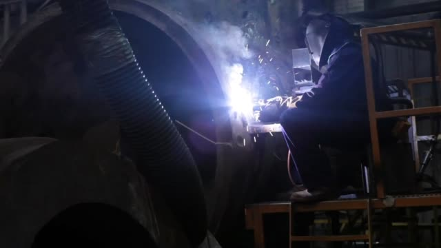Sparks fly as an employee works on a forged component at Sheffield Forgemasters International Ltd in Sheffield UK on Monday July 22 A large steel...