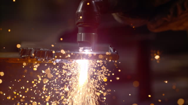 SLO MO TD Sparks flying from the cutting tool