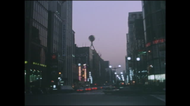 Sparse neon lights illuminate the Ginza to save power during the oil crisis.