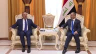 Speaker of Iraq's Council of Representatives Salim alJabouri meets with Turkish Foreign Minister Mevlut Cavusoglu in Baghdad Iraq on August 23 2017