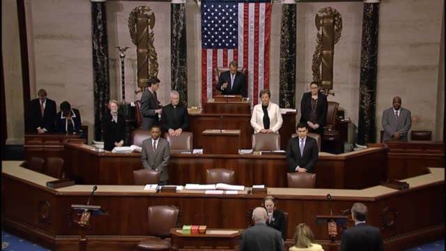 Speaker the House John Boehner gavels in a session of the House of Representatives introduces guest chaplain
