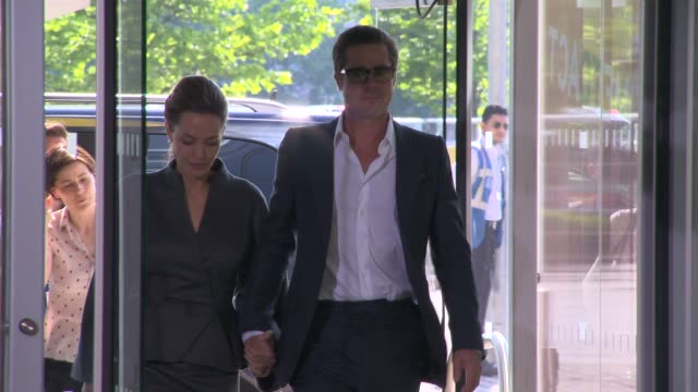 Special Envoy Angelina Jolie and Brad Pitt arrive at the End Sexual Violence in Conflict Global Summit at ExCel on June 13 2014 in London England