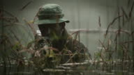 CU U.S. Special Operation Forces gunner with M60 machine gun in Vietnam war / Jungle, Hue, Vietnam