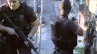 CU Special Operations force of the Rio de Janeiro Police Brazil's equivalent of a SWAT Team searches the Complexo do Alemão Favela in Rio de...