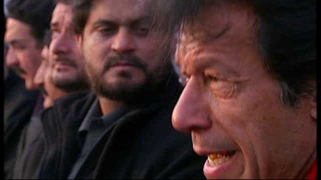 Special report on Imran Khan Reporter to camera Vox pops Close shot Khan's notes for speech Khan speech SOT Young Pakistani women Imran Khan speech...