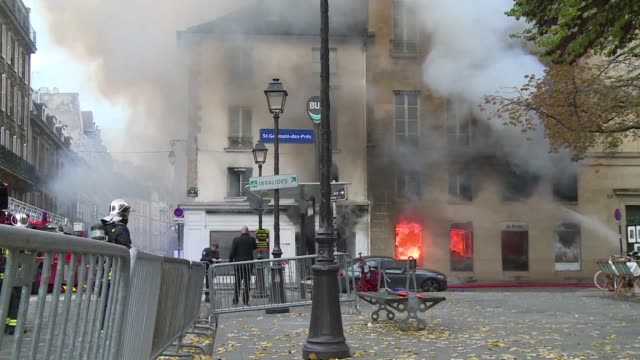A spectacular fire tore through a library of art and photography on Thursday in Paris's touristic quarter of SaintGermaindesPres the historic centre...