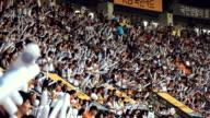 MS Spectator cheering with cheering bang stick balloon in baseball stadium / Seoul, South Korea