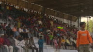 Spectators cheer while seated at cricket match Available in HD.