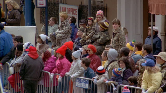 Spectators enjoy a New Orleans Mardi Gras parade