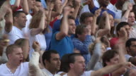 MS PAN Spectators in bleachers cheering, London, UK