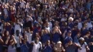 WS Spectators in bleachers cheering, London, UK