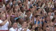 MS Spectators in bleachers clapping hands, London, UK