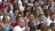 MS TD Spectators in bleachers clapping hands, London, UK